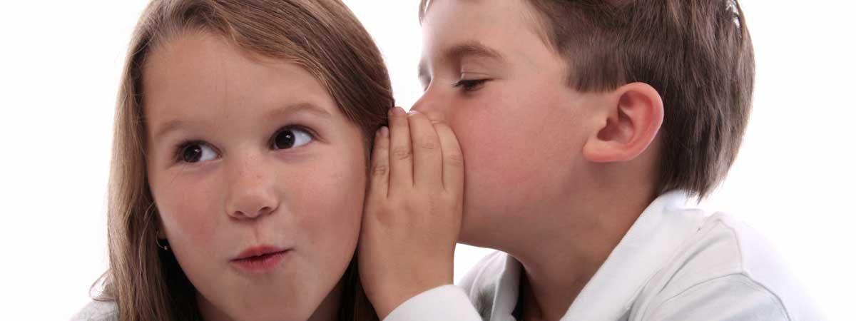 Boy Whispering Something Important to His Friend